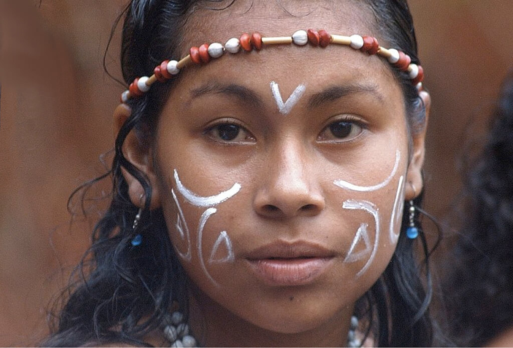 A Kalinago girl wearing traditional ornamentation.