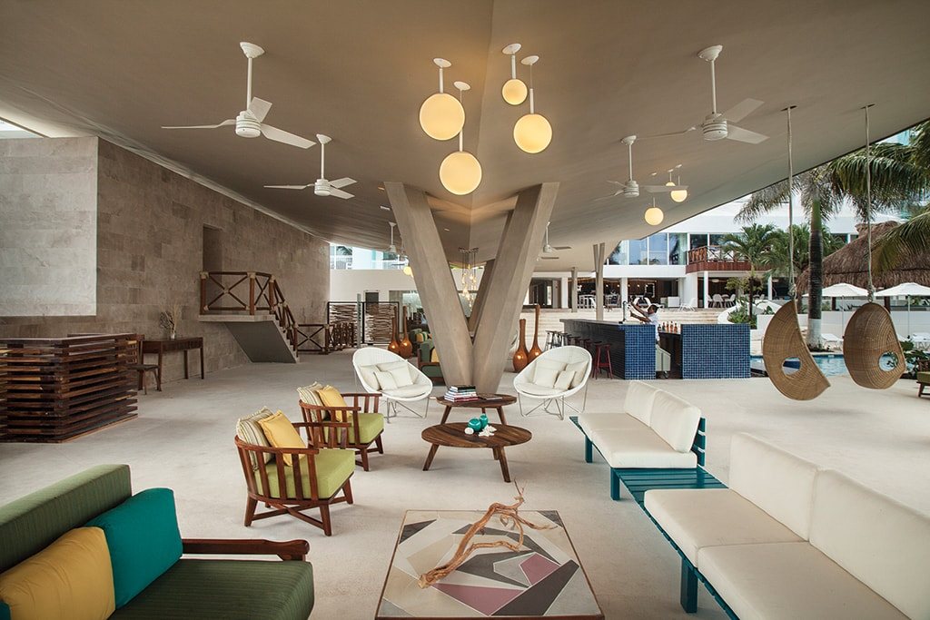 The open-air lobby at Fiesta Americana reflects the mid-century modern design theme that carries throughout the property.