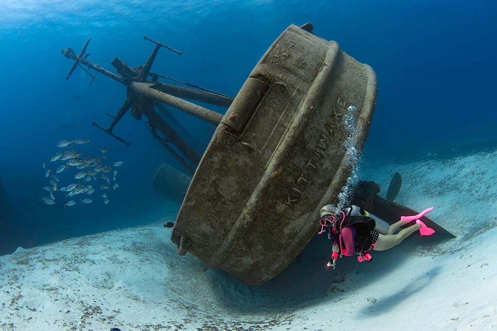 At 251 feet in length, the USS Kittiwake is Grand Cayman's largest and most popular shipwreck.