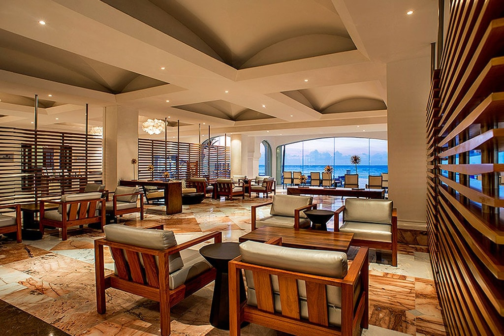 The marble-floor lobby of the Cozumel Palace opens to ocean views.