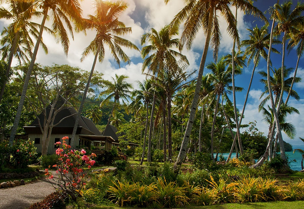 Cottages at Lalati Resort are built in traditional Fijian style, and feature porches with ocean views.