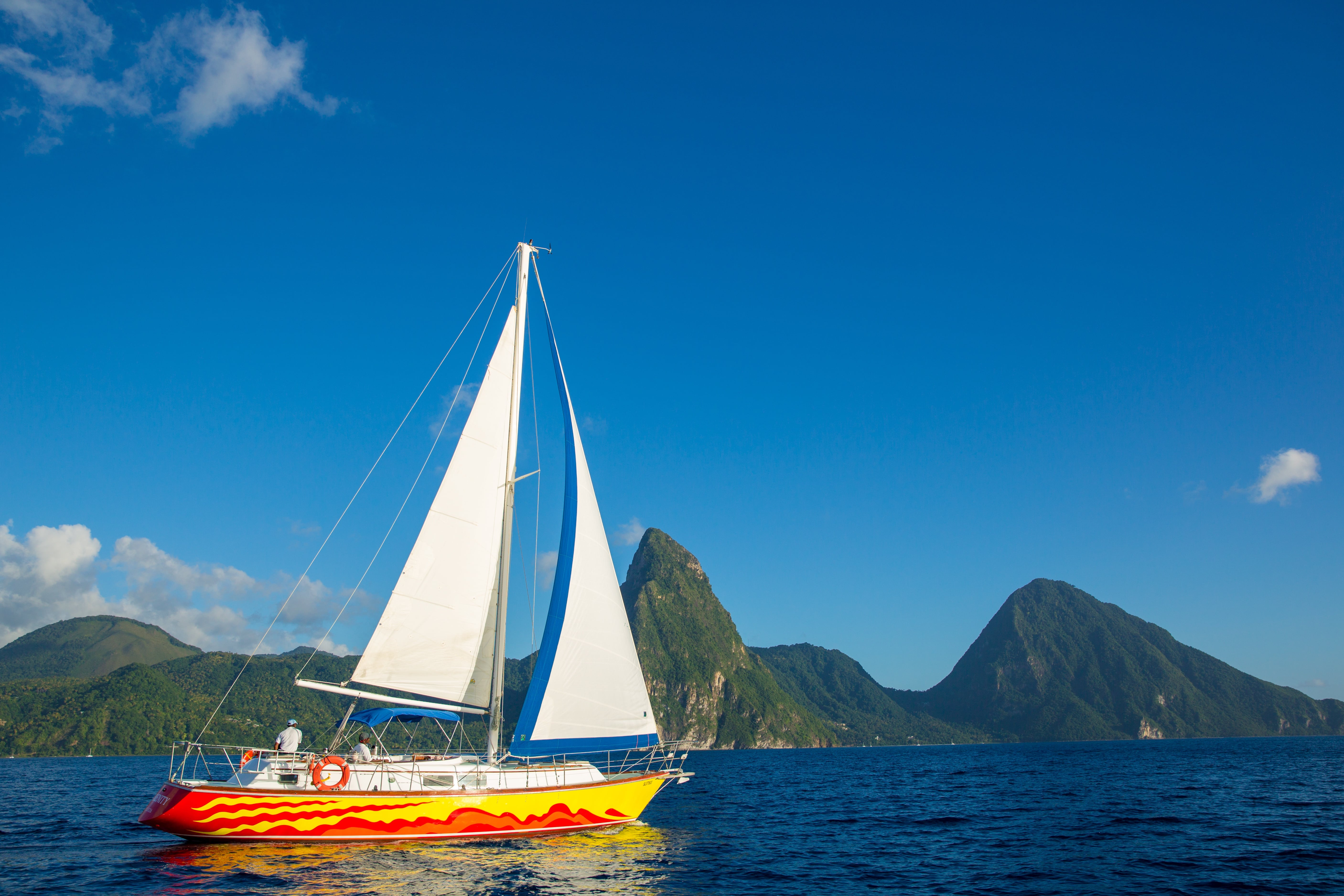 St. Lucia's west coast is sheltered from prevailing trade winds, providing calm, clear waters ideal for relaxing sailing trips.