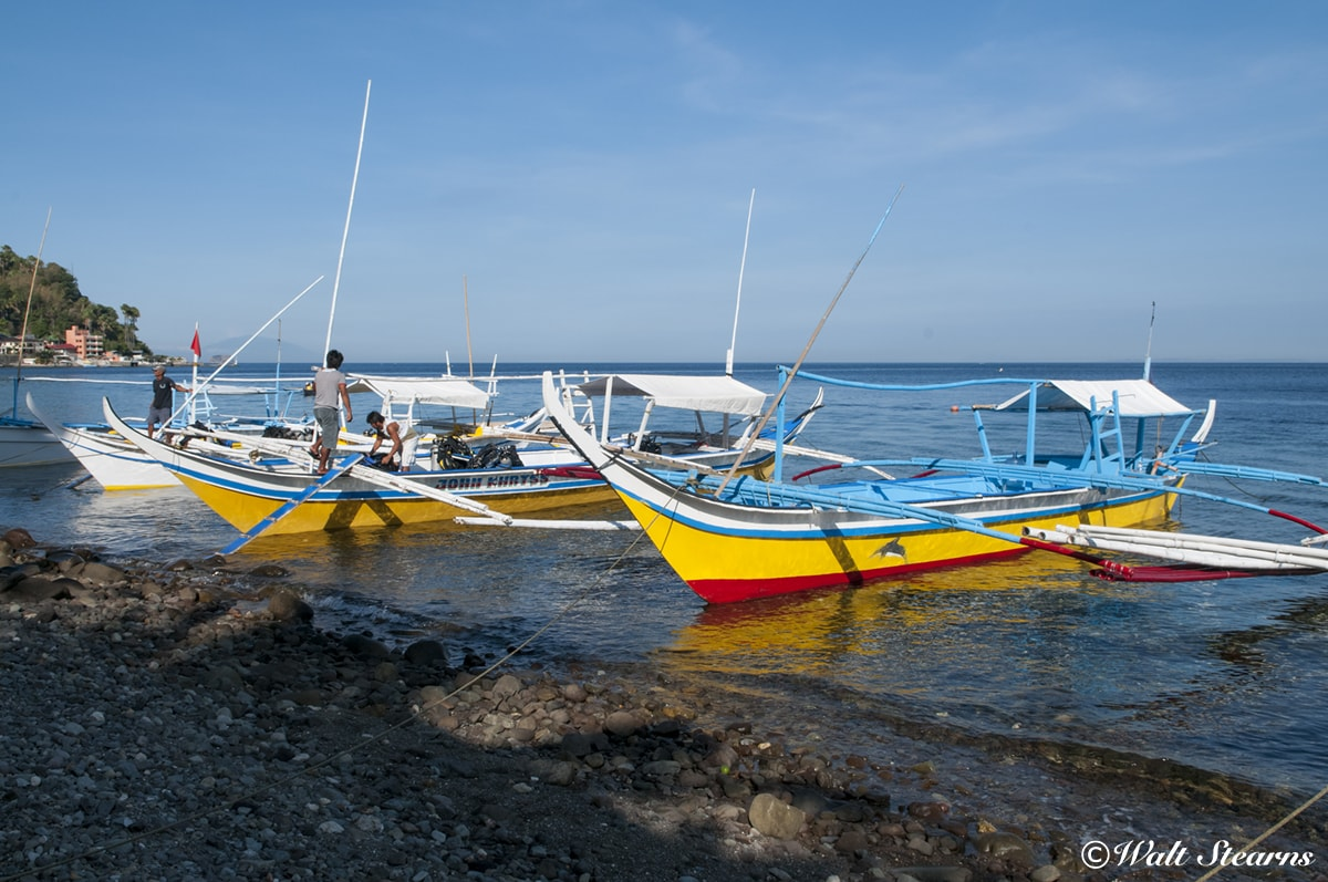Dive boats are known as Bangkas line the shore at Anilao. With most dive sites just minutes from resorts
