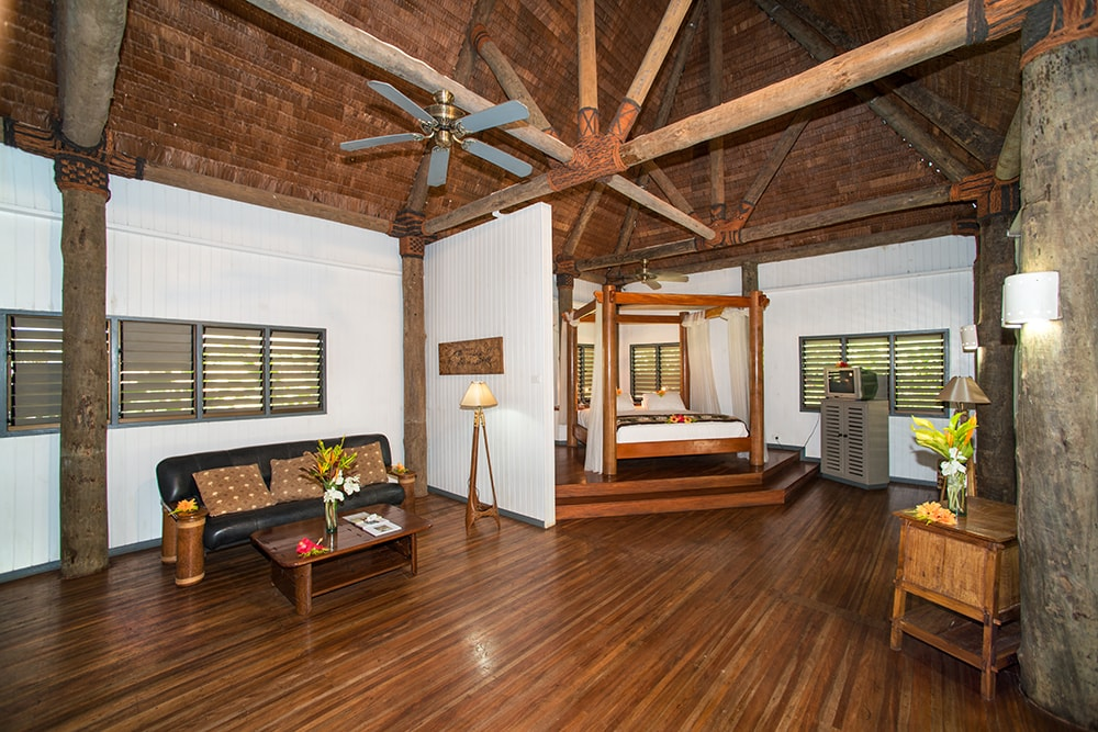 Vaulted ceilings and rich woodwork add a sense of spacious comfort to the resort bures.