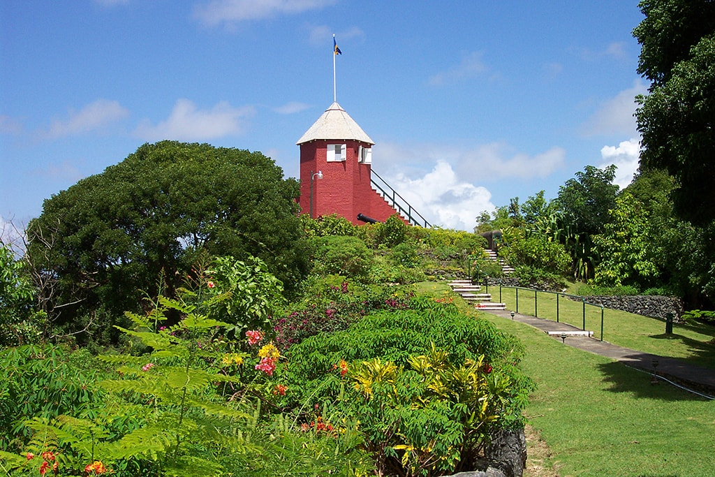 A hike to the summit of Gun Hill Signal Station passes through manicured gardens to deliver captivating views of the entire island.