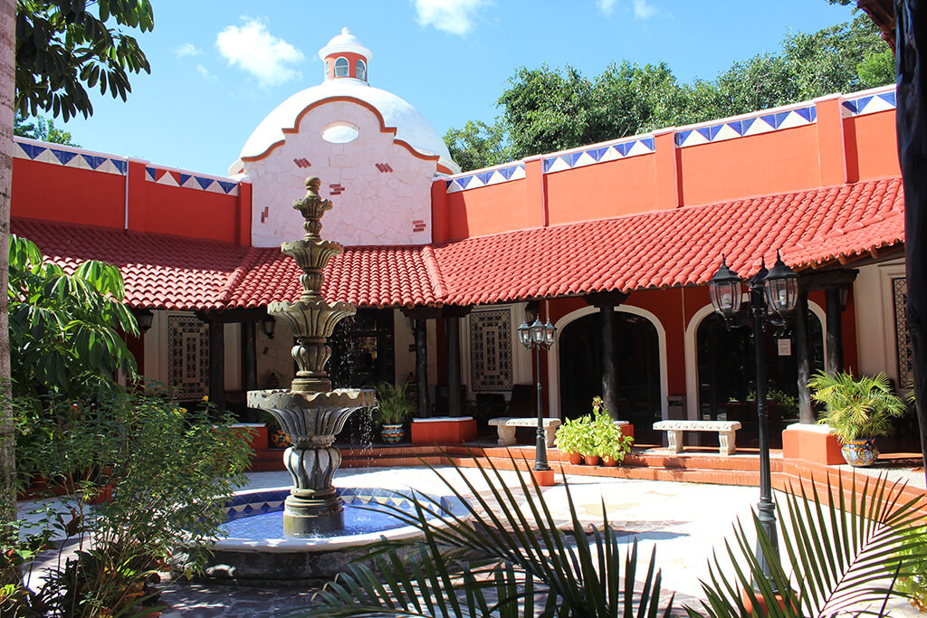 Red tile roofs and traditional hacienda-style architecture set the tone at Occidental Cozumel.