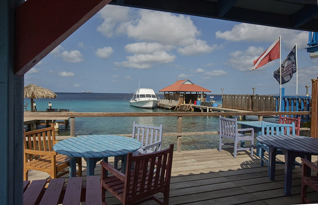 Just steps away from boats and the shop, divers can relax in a casual setting with waterfront views before or between dives.