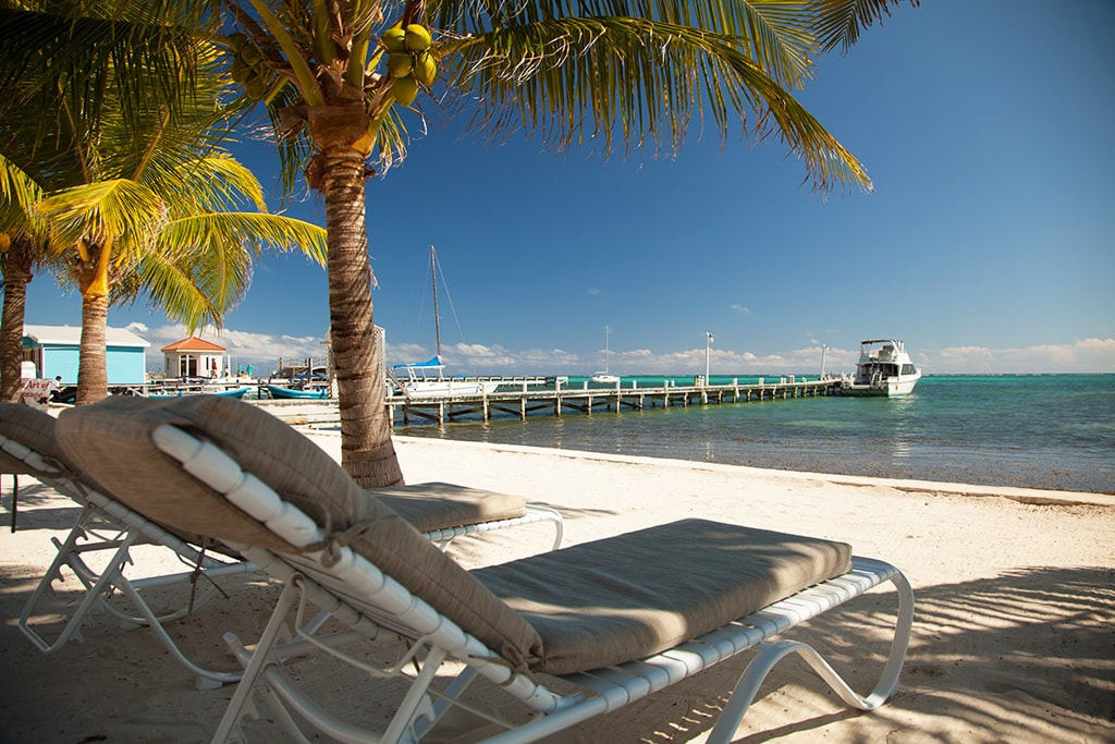 On Belize's Ambergris Caye, beachfront dive resorts are just a short boat ride away from the barrier reef.