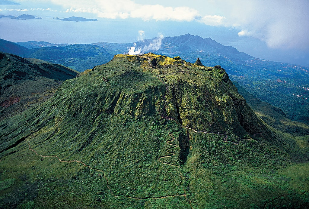 La Soufrière Volcano rises nearly a mile above the island of Basse-Terre. The climb to the summit is challenging but rewarding.