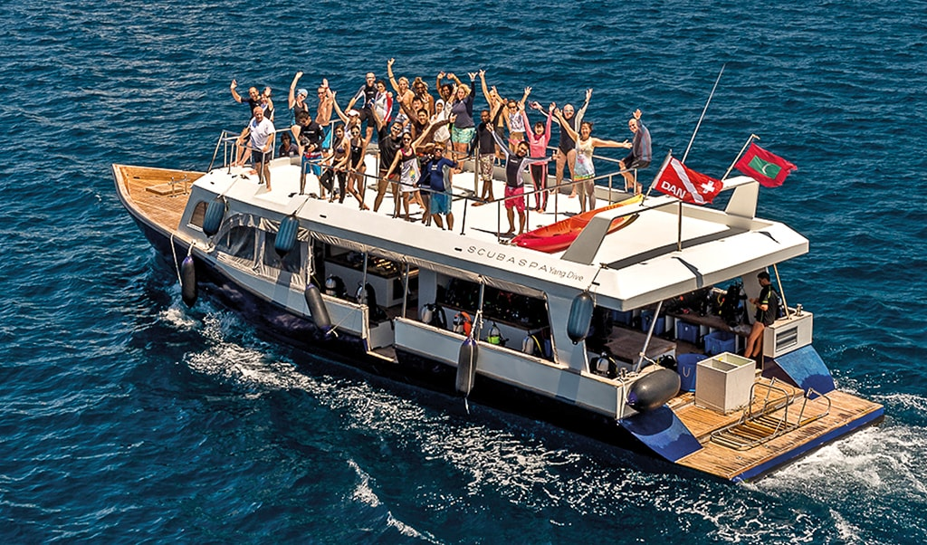 Dive liveaboards in the Maldives are often accompanied by well-appointed dhonis that support daily diving operations.
