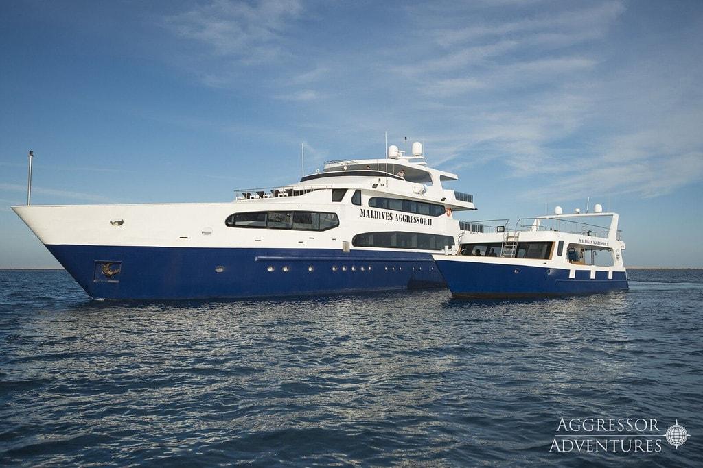 The Maldives Aggressor II alongside its custom-built dhoni dive tender.
