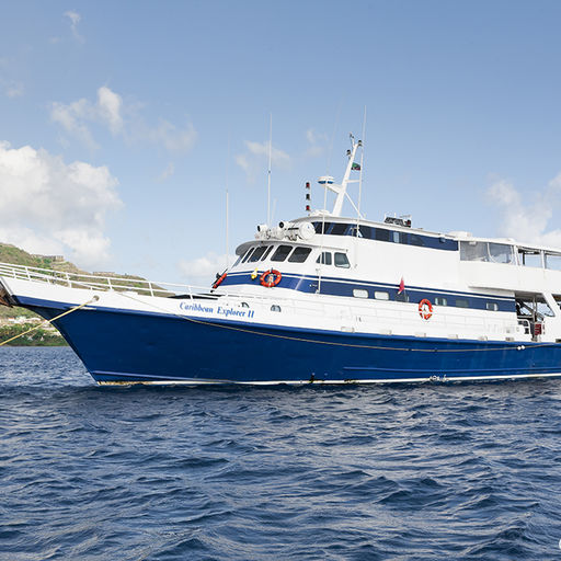 The Caribbean Explorer II rests on a mooring off the calm western coast of St. Kitts
