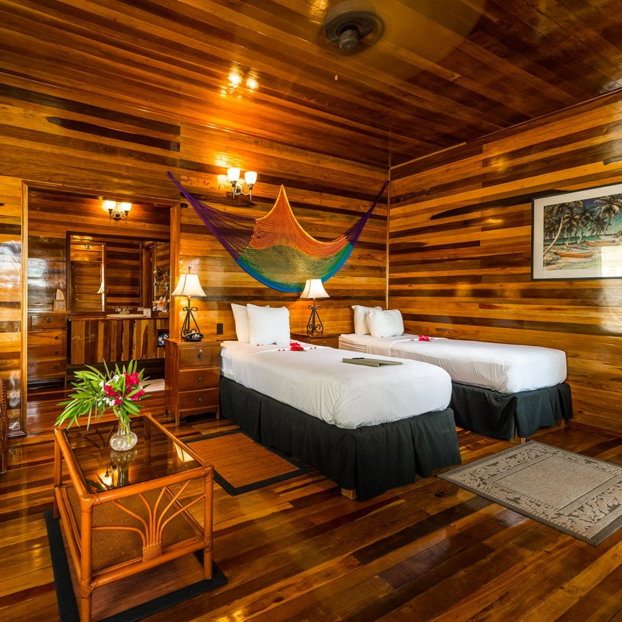 Rich mahogany and teak woodwork add a warm ambiance to a Deluxe Room. Guests have the option of twin beds or a single king.