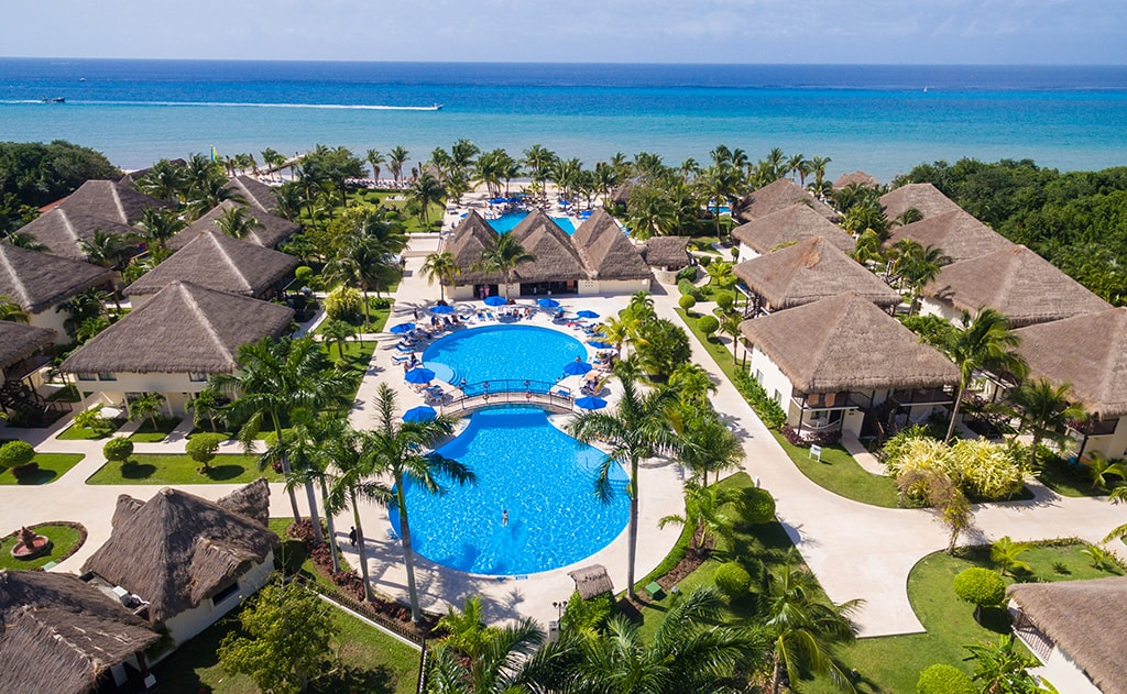 The two-story guest houses of the Allegro Resort cluster around resort pools, and are adjacent to Cozumel's San Francisco Beach.