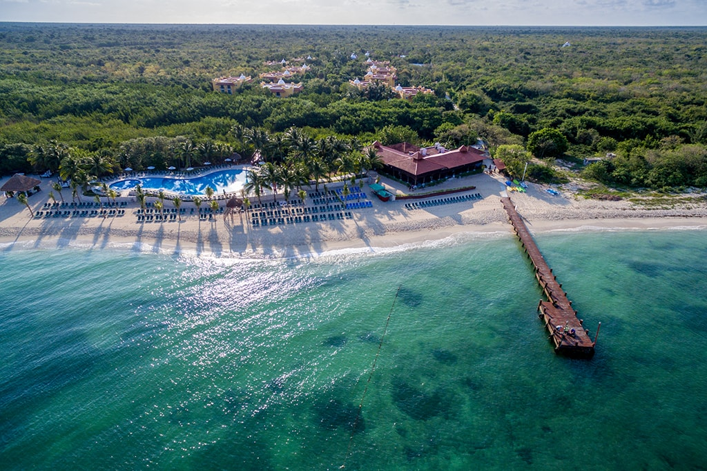 The guest residences at the Occidental Cozumel Resort are set back from the beach within a private nature preserve. The dive center is located next to the pier.