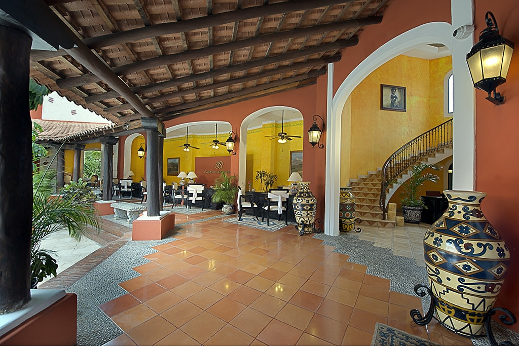 Warm tones and shaded verandahs create an inviting and relaxing atmosphere at the Occidental Cozumel Resort.