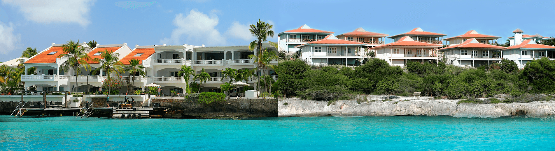 A Caribbean dive trip should also be a relaxing vacation. That's why in-the-know divers prefer the spacious comfort of Bonaire's Caribbean Club (seen on the right) and Belmar Oceanfront Apartments (seen on the left) for their vacations.