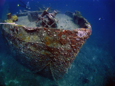 The bow of a ship wreck comes into view from the depths in Grenada