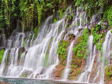 There are many natural treats to see and experience like this cascading waterfall when touring Honduras mainland as part of your scuba diving vacation